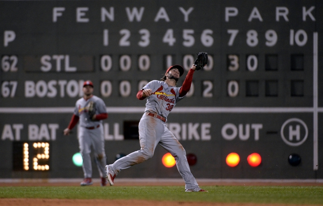 Oct 24, 2013; Boston, MA, USA; St. Louis Cardinals shortstop Pete Kozma (38) catches a pop up by Boston Red Sox first baseman Mike Napoli (not pictured) in the 8th inning during game two of the MLB baseball World Series at Fenway Park. Mandatory Credit: Robert Deutsch-USA TODAY Sports