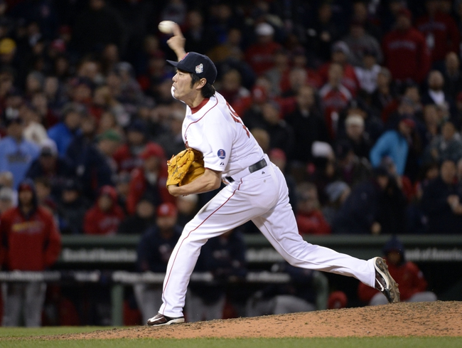 Oct 24, 2013; Boston, MA, USA; Boston Red Sox relief pitcher Koji Uehara throws a pitch against the St. Louis Cardinals in the 9th inning during game two of the MLB baseball World Series at Fenway Park. Mandatory Credit: Robert Deutsch-USA TODAY Sports