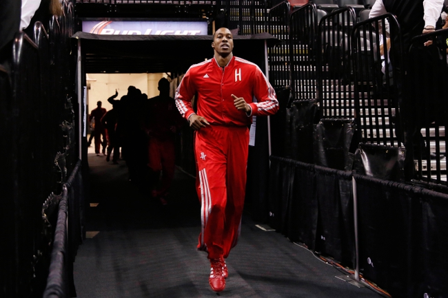Oct 24, 2013; San Antonio, TX, USA; Houston Rockets center Dwight Howard (12) runs out of the tunnel before the game against the San Antonio Spurs at AT&T Center. Mandatory Credit: Soobum Im-USA TODAY Sports