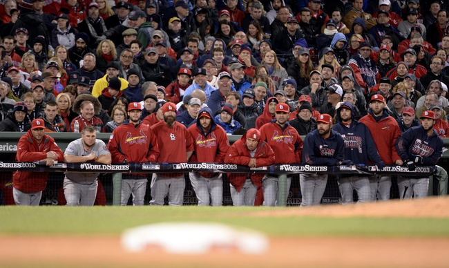 Oct 24, 2013; Boston, MA, USA; St. Louis Cardinals players look out from the dugout in the 9th inning during game two of the MLB baseball World Series against the Boston Red Sox at Fenway Park. Mandatory Credit: Robert Deutsch-USA TODAY Sports