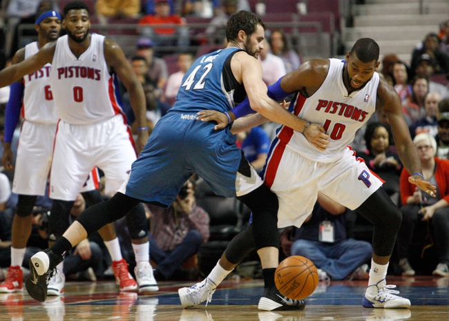 Oct 24, 2013; Auburn Hills, MI, USA; Detroit Pistons center Greg Monroe (10) gets fouled by Minnesota Timberwolves power forward Kevin Love (42) during the third quarter at The Palace of Auburn Hills. Pistons beat the Timberwolves 99-98. Mandatory Credit: Raj Mehta-USA TODAY Sports