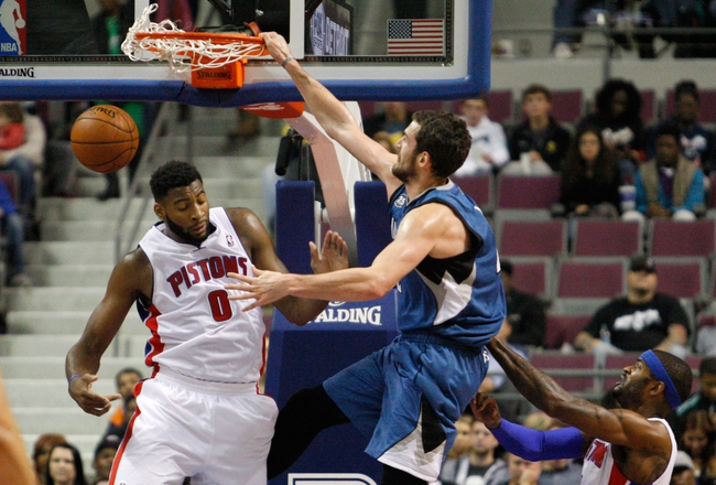 Oct 24, 2013; Auburn Hills, MI, USA; Minnesota Timberwolves power forward Kevin Love (42) makes a dunk on Detroit Pistons center Andre Drummond (0) during the third quarter at The Palace of Auburn Hills. Pistons beat the Timberwolves 99-98. Mandatory Credit: Raj Mehta-USA TODAY Sports