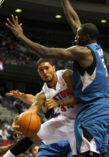 Oct 24, 2013; Auburn Hills, MI, USA; Detroit Pistons point guard Peyton Siva (34) makes a no look pass against Minnesota Timberwolves center Gorgui Dieng (5) during the third quarter at The Palace of Auburn Hills. Pistons beat the Timberwolves 99-98. Mandatory Credit: Raj Mehta-USA TODAY Sports