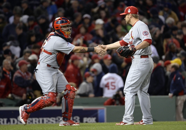 Oct 24, 2013; Boston, MA, USA; St. Louis Cardinals relief pitcher Trevor Rosenthal (right) celebrates with catcher Yadier Molina (left) after game two of the MLB baseball World Series against the Boston Red Sox at Fenway Park. Mandatory Credit: Robert Deutsch-USA TODAY Sports