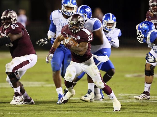 Oct 24, 2013; Starkville, MS, USA; Mississippi State Bulldogs running back LaDarius Perkins (27) advances the ball during the game against the Kentucky Wildcats at Davis Wade Stadium. Mississippi State Bulldogs win the game against Kentucky Wildcats 28-22.  Mandatory Credit: Spruce Derden-USA TODAY Sports