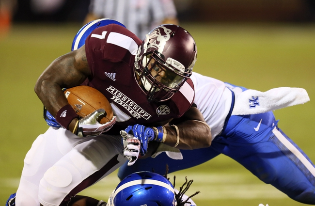 Oct 24, 2013; Starkville, MS, USA; Mississippi State Bulldogs running back Nick Griffin (7) advances the ball during the game against the Kentucky Wildcats at Davis Wade Stadium. Mississippi State Bulldogs win the game against Kentucky Wildcats 28-22.  Mandatory Credit: Spruce Derden-USA TODAY Sports