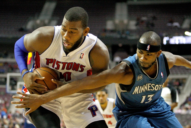 Oct 24, 2013; Auburn Hills, MI, USA; Detroit Pistons center Greg Monroe (10) gets defended by Minnesota Timberwolves small forward Corey Brewer (13) during the fourth quarter at The Palace of Auburn Hills. Pistons beat the Timberwolves 99-98. Mandatory Credit: Raj Mehta-USA TODAY Sports