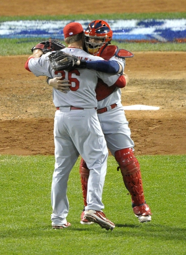 Oct 24, 2013; Boston, MA, USA; St. Louis Cardinals relief pitcher Trevor Rosenthal (26) celebrates with catcher Yadier Molina (right) after game two of the MLB baseball World Series against the Boston Red Sox at Fenway Park. Mandatory Credit: Bob DeChiara-USA TODAY Sports
