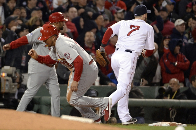 Oct 24, 2013; Boston, MA, USA; St. Louis Cardinals center fielder Jon Jay (19) gets up and runs home to score a run after the ball gets away from Boston Red Sox shortstop Stephen Drew (7) in the 7th inning during game two of the MLB baseball World Series at Fenway Park. Mandatory Credit: Robert Deutsch-USA TODAY Sports