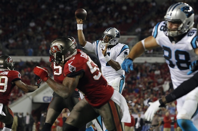Oct 24, 2013; Tampa, FL, USA; Carolina Panthers quarterback Cam Newton (1) throws the ball for a touchdown during the second half against the Tampa Bay Buccaneers at Raymond James Stadium. Carolina Panthers defeated the Tampa Bay Buccaneers 31-13. Mandatory Credit: Kim Klement-USA TODAY Sports