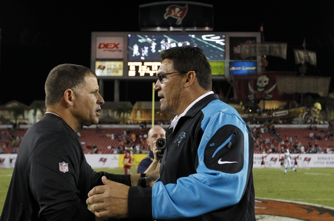 Oct 24, 2013; Tampa, FL, USA; Tampa Bay Buccaneers head coach Greg Schiano and Carolina Panthers head coach Ron Rivera greet each other at the end of the game at Raymond James Stadium. Carolina Panthers defeated the Tampa Bay Buccaneers 31-13. Mandatory Credit: Kim Klement-USA TODAY Sports