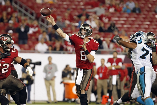 Oct 24, 2013; Tampa, FL, USA; Tampa Bay Buccaneers quarterback Mike Glennon (8) throws the ball against the Carolina Panthers during the second half at Raymond James Stadium. Carolina Panthers defeated the Tampa Bay Buccaneers 31-13. Mandatory Credit: Kim Klement-USA TODAY Sports