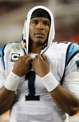 Oct 24, 2013; Tampa, FL, USA; Carolina Panthers quarterback Cam Newton (1) on the sidelines during the second half against the Tampa Bay Buccaneers at Raymond James Stadium. Carolina Panthers defeated the Tampa Bay Buccaneers 31-13. Mandatory Credit: Kim Klement-USA TODAY Sports