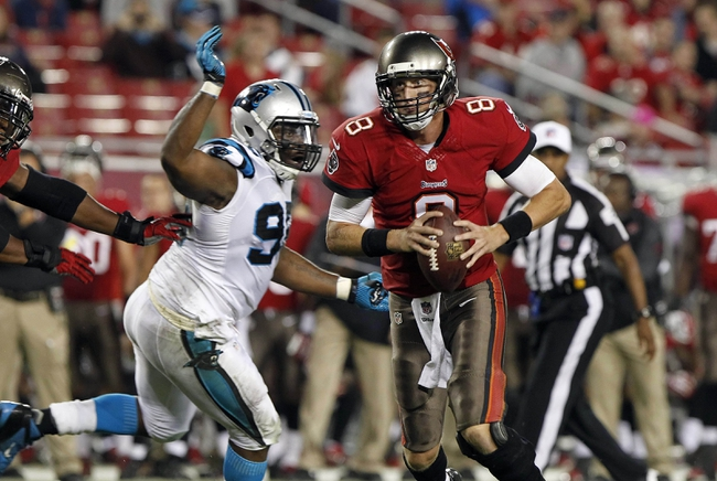 Oct 24, 2013; Tampa, FL, USA; Tampa Bay Buccaneers quarterback Mike Glennon (8) runs with the ball against the Carolina Panthers during the second half at Raymond James Stadium. Carolina Panthers defeated the Tampa Bay Buccaneers 31-13. Mandatory Credit: Kim Klement-USA TODAY Sports