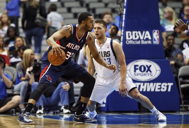 Oct 23, 2013; Dallas, TX, USA; Atlanta Hawks power forward Mike Scott (32) looks to drive as Dallas Mavericks point guard Gal Mekel (33) defends during the game at American Airlines Center. Dallas won 99-88. Mandatory Credit: Kevin Jairaj-USA TODAY Sports