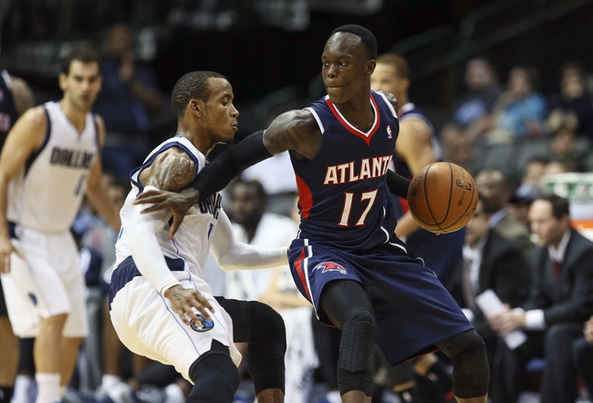 Oct 23, 2013; Dallas, TX, USA; Atlanta Hawks point guard Dennis Schroder (17) dribbles as Dallas Mavericks point guard Monta Ellis (11) defends during the game at American Airlines Center. Dallas won 99-88. Mandatory Credit: Kevin Jairaj-USA TODAY Sports