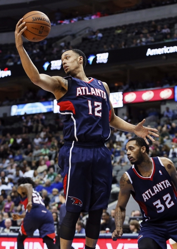 Oct 23, 2013; Dallas, TX, USA; Atlanta Hawks shooting guard John Jenkins (12) grabs a rebound during the game against the Dallas Mavericks at American Airlines Center. Dallas won 99-88. Mandatory Credit: Kevin Jairaj-USA TODAY Sports