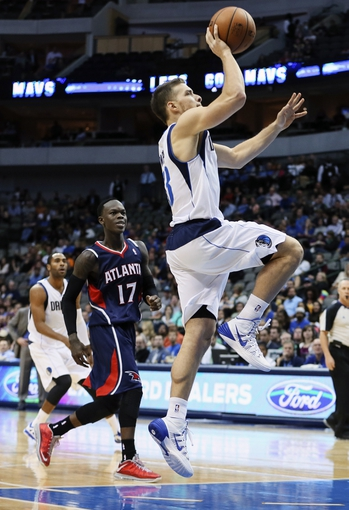 Oct 23, 2013; Dallas, TX, USA; Dallas Mavericks point guard Gal Mekel (33) shoots during the game against the Atlanta Hawks at American Airlines Center. Dallas won 99-88. Mandatory Credit: Kevin Jairaj-USA TODAY Sports