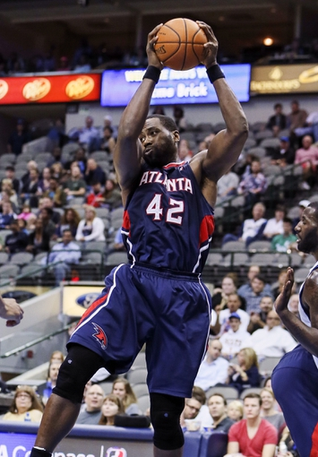 Oct 23, 2013; Dallas, TX, USA; Atlanta Hawks power forward Elton Brand (42) grabs a rebound during the game against the Dallas Mavericks at American Airlines Center. Dallas won 99-88. Mandatory Credit: Kevin Jairaj-USA TODAY Sports