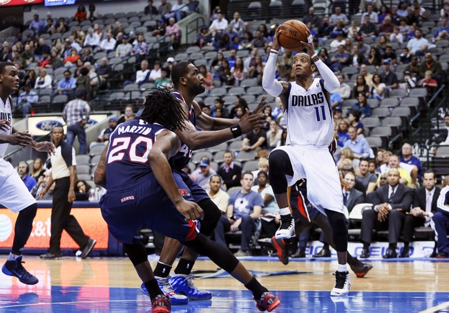 Oct 23, 2013; Dallas, TX, USA; Dallas Mavericks point guard Monta Ellis (11) shoots during the game against the Atlanta Hawks at American Airlines Center. Dallas won 99-88. Mandatory Credit: Kevin Jairaj-USA TODAY Sports