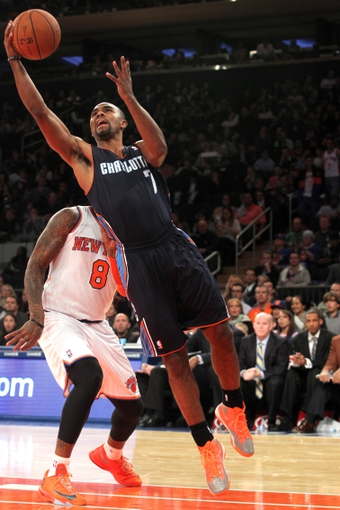Oct 25, 2013; New York, NY, USA; Charlotte Bobcats point guard Ramon Sessions (7) drives to the basket on New York Knicks shooting guard J.R. Smith (8) during the second quarter of a preseason game at Madison Square Garden. Mandatory Credit: Brad Penner-USA TODAY Sports