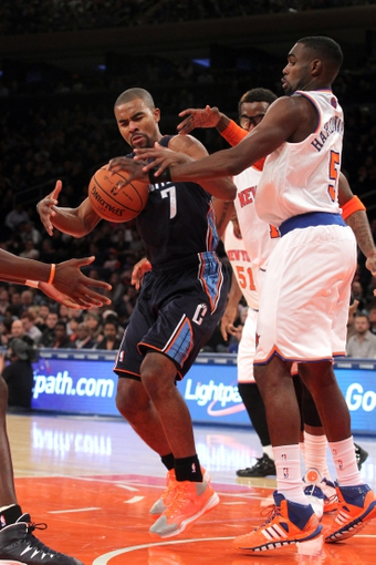 Oct 25, 2013; New York, NY, USA; Charlotte Bobcats point guard Ramon Sessions (7) loses control of the ball in front of New York Knicks power forward Amar'e Stoudemire (1) and shooting guard Tim Hardaway Jr. (5) during the second quarter of a preseason game at Madison Square Garden. Mandatory Credit: Brad Penner-USA TODAY Sports
