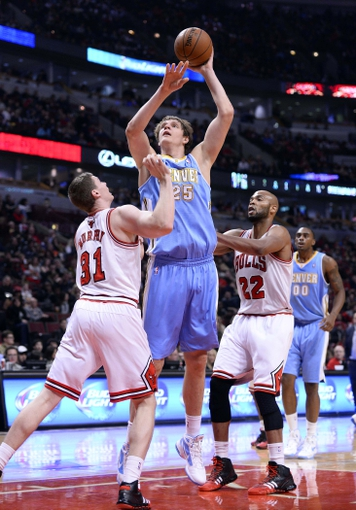 Oct 25, 2013; Chicago, IL, USA; Denver Nuggets center Timofey Mozgov (25) shoots the ball against Chicago Bulls power forward Erik Murphy (31) during the second quarter at the United Center. Mandatory Credit: Mike DiNovo-USA TODAY Sports