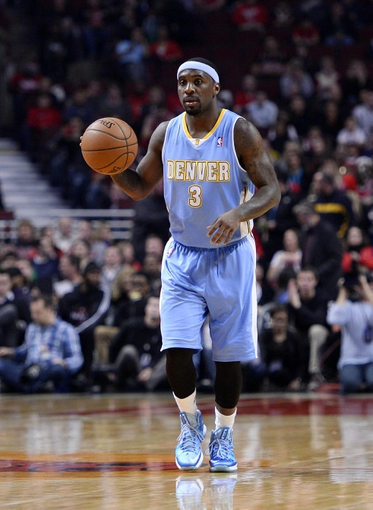 Oct 25, 2013; Chicago, IL, USA; Denver Nuggets point guard Ty Lawson (3) dribbles the ball against the Chicago Bulls during the first quarter at the United Center. Mandatory Credit: Mike DiNovo-USA TODAY Sports