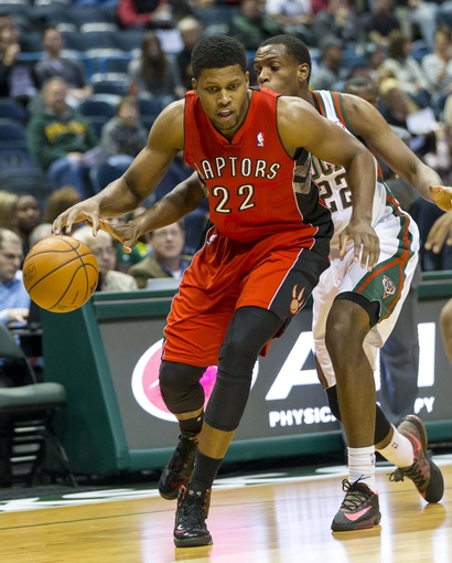 Oct 25, 2013; Milwaukee, WI, USA;  Toronto Raptors forward Rudy Gay (22) drives for the basket around Milwaukee Bucks forward Khris Middleton (22) during the first quarter of the game at the BMO Harris Bradley Center. Mandatory Credit: Jeff Hanisch-USA TODAY Sports