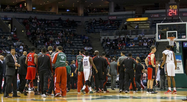 Oct 25, 2013; Milwaukee, WI, USA;  The Toronto Raptors and Milwaukee Bucks walk off the court during the first quarter of the game at BMO Harris Bradley Center.  The game was cancelled in the first quarter after the floor was deemed unsafe to play on.  Mandatory Credit: Jeff Hanisch-USA TODAY Sports