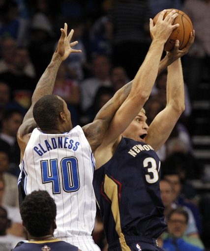 Oct 25, 2013; Orlando, FL, USA; Orlando Magic center Mickell Gladness (40) and New Orleans Pelicans center Greg Stiemsma (34) go after the rebound during the second half at Amway Center. New Orleans Pelicans defeated the Orlando Magic 101-82.  Mandatory Credit: Kim Klement-USA TODAY Sports