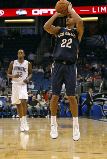 Oct 25, 2013; Orlando, FL, USA; New Orleans Pelicans point guard Brian Roberts (22) shoots a three pointer against the Orlando Magic during the second half at Amway Center. New Orleans Pelicans defeated the Orlando Magic 101-82.  Mandatory Credit: Kim Klement-USA TODAY Sports