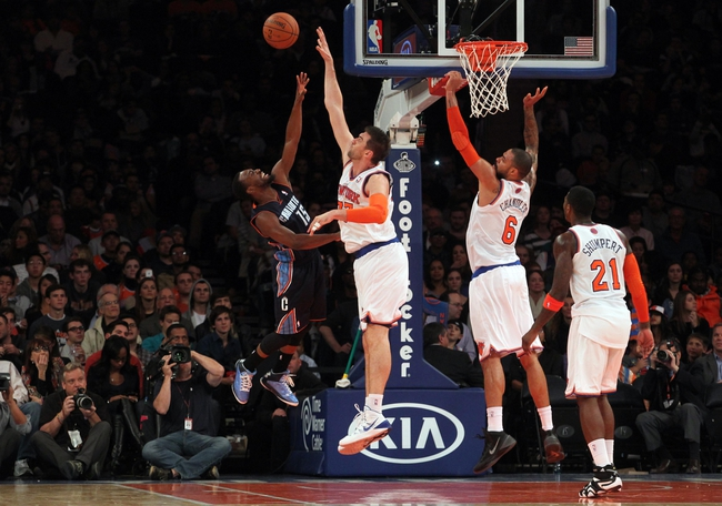 Oct 25, 2013; New York, NY, USA; Charlotte Bobcats point guard Kemba Walker (15) has his shot blocked by New York Knicks power forward Andrea Bargnani (77) in front of center Tyson Chandler (6) and shooting guard Iman Shumpert (21) during the third quarter of a preseason game at Madison Square Garden. Mandatory Credit: Brad Penner-USA TODAY Sports