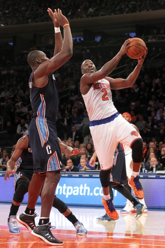 Oct 25, 2013; New York, NY, USA; New York Knicks point guard Raymond Felton (2) drives to the basket past Charlotte Bobcats power forward Bismack Biyombo (0) during the third quarter of a preseason game at Madison Square Garden. Mandatory Credit: Brad Penner-USA TODAY Sports