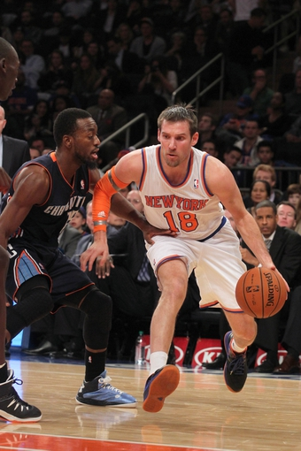 Oct 25, 2013; New York, NY, USA; New York Knicks point guard Beno Udrih (18) drives on Charlotte Bobcats point guard Kemba Walker (15) during the fourth quarter of a preseason game at Madison Square Garden. Mandatory Credit: Brad Penner-USA TODAY Sports