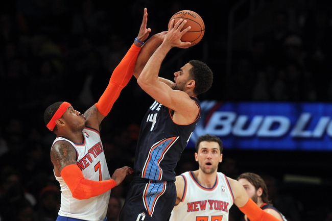 Oct 25, 2013; New York, NY, USA; Charlotte Bobcats small forward Jeffery Taylor (44) shoots over New York Knicks small forward Carmelo Anthony (7) in front of Knicks power forward Andrea Bargnani (77) during the third quarter of a preseason game at Madison Square Garden. Mandatory Credit: Brad Penner-USA TODAY Sports