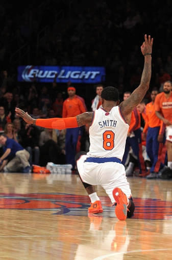 Oct 25, 2013; New York, NY, USA; New York Knicks shooting guard J.R. Smith (8) reacts to hitting a three point shot against the Charlotte Bobcats at the buzzer ending the third quarter of a preseason game at Madison Square Garden. Mandatory Credit: Brad Penner-USA TODAY Sports