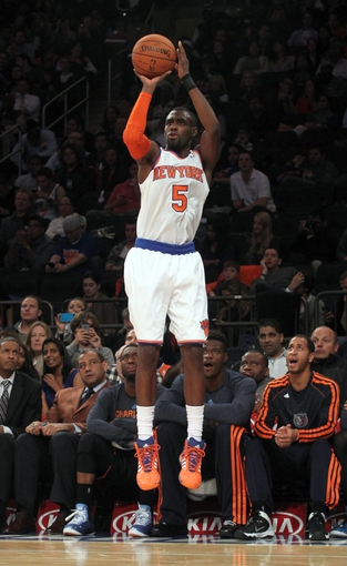 Oct 25, 2013; New York, NY, USA; New York Knicks shooting guard Tim Hardaway Jr. (5) shoots a three-point shot against the Charlotte Bobcats during the fourth quarter of a preseason game at Madison Square Garden. Mandatory Credit: Brad Penner-USA TODAY Sports