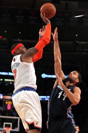 Oct 25, 2013; New York, NY, USA; New York Knicks small forward Carmelo Anthony (7) shoots defended by Charlotte Bobcats small forward Jeffery Taylor (44) during the fourth quarter of a preseason game at Madison Square Garden. Mandatory Credit: Brad Penner-USA TODAY Sports