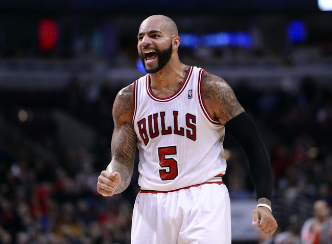 Oct 25, 2013; Chicago, IL, USA; Chicago Bulls power forward Carlos Boozer (5) reacts after a basket against the Denver Nuggets during the second half at the United Center. Chicago defeats Denver 94-89. Mandatory Credit: Mike DiNovo-USA TODAY Sports
