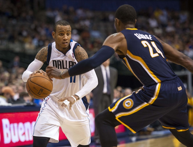 Oct 25, 2013; Dallas, TX, USA; Indiana Pacers shooting guard Paul George (24) defends against Dallas Mavericks point guard Monta Ellis (11) during the second half at the American Airlines Center. The Pacers defeated the Mavericks 98-77. Mandatory Credit: Jerome Miron-USA TODAY Sports