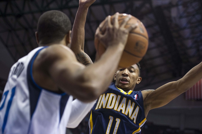 Oct 25, 2013; Dallas, TX, USA; Indiana Pacers shooting guard Orlando Johnson (11) defends against Dallas Mavericks shooting guard Wayne Ellington (21) during the second half at the American Airlines Center. The Pacers defeated the Mavericks 98-77. Mandatory Credit: Jerome Miron-USA TODAY Sports
