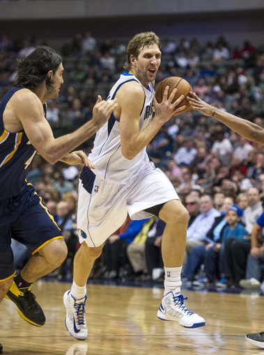 Oct 25, 2013; Dallas, TX, USA; Dallas Mavericks power forward Dirk Nowitzki (41) drives to the basket past Indiana Pacers power forward Luis Scola (4) during the second half at the American Airlines Center. The Pacers defeated the Mavericks 98-77. Mandatory Credit: Jerome Miron-USA TODAY Sports