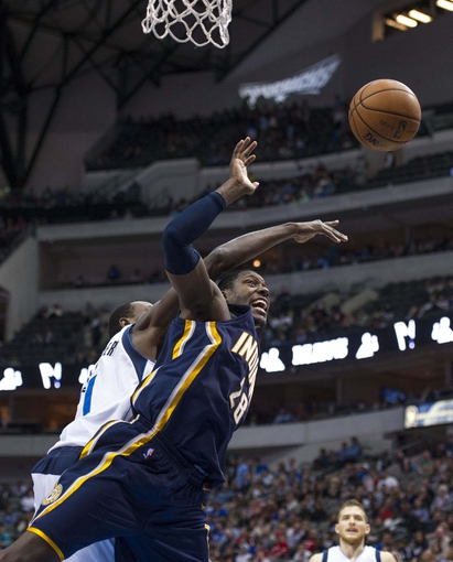 Oct 25, 2013; Dallas, TX, USA; Dallas Mavericks center Samuel Dalembert (1) and Indiana Pacers center Ian Mahinmi (28) fight for the rebound during the second half at the American Airlines Center. The Pacers defeated the Mavericks 98-77. Mandatory Credit: Jerome Miron-USA TODAY Sports