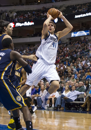 Oct 25, 2013; Dallas, TX, USA; Dallas Mavericks power forward Dirk Nowitzki (41) shoots a jump shot against the Indiana Pacers during the second half at the American Airlines Center. The Pacers defeated the Mavericks 98-77. Mandatory Credit: Jerome Miron-USA TODAY Sports