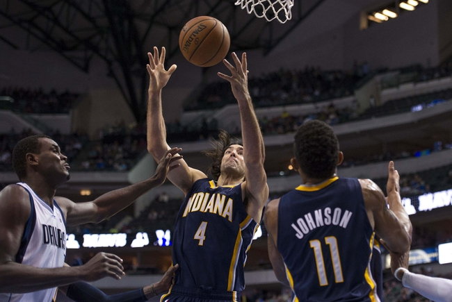 Oct 25, 2013; Dallas, TX, USA; Indiana Pacers power forward Luis Scola (4) grabs a rebound in front of Dallas Mavericks center Samuel Dalembert (1) during the second half at the American Airlines Center. The Pacers defeated the Mavericks 98-77. Mandatory Credit: Jerome Miron-USA TODAY Sports
