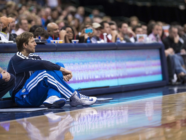 Oct 25, 2013; Dallas, TX, USA; Dallas Mavericks power forward Dirk Nowitzki (41) watches the game between the Mavericks and the Indiana Pacers during the second half at the American Airlines Center. The Pacers defeated the Mavericks 98-77. Mandatory Credit: Jerome Miron-USA TODAY Sports