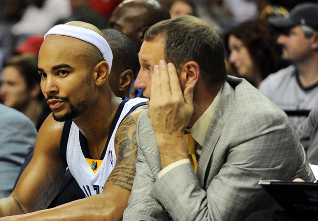 Oct 25, 2013; Memphis, TN, USA; Memphis Grizzlies point guard Jerryd Bayless (7) sits on the bench during the third quarter against Houston Rockets at FedExForum. The Rockets won 92-73. Mandatory Credit: Justin Ford-USA TODAY Sports