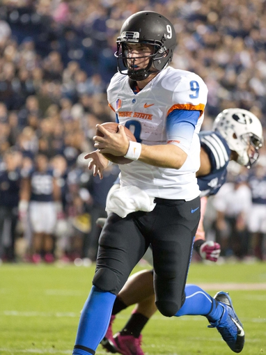 Oct 25, 2013; Provo, UT, USA; Boise State Broncos quarterback Grant Hedrick (9) scores a touchdown during the second half against the Brigham Young Cougars at Lavell Edwards Stadium. Brigham Young won 37-20. Mandatory Credit: Russ Isabella-USA TODAY Sports
