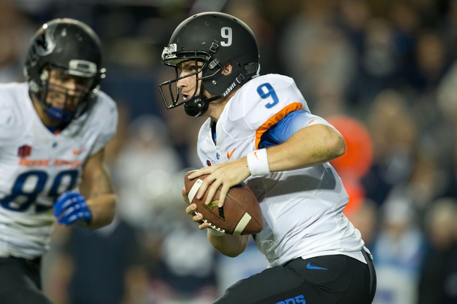 Oct 25, 2013; Provo, UT, USA; Boise State Broncos quarterback Grant Hedrick (9) scrambles during the second half against the Brigham Young Cougars at Lavell Edwards Stadium. Brigham Young won 37-20. Mandatory Credit: Russ Isabella-USA TODAY Sports